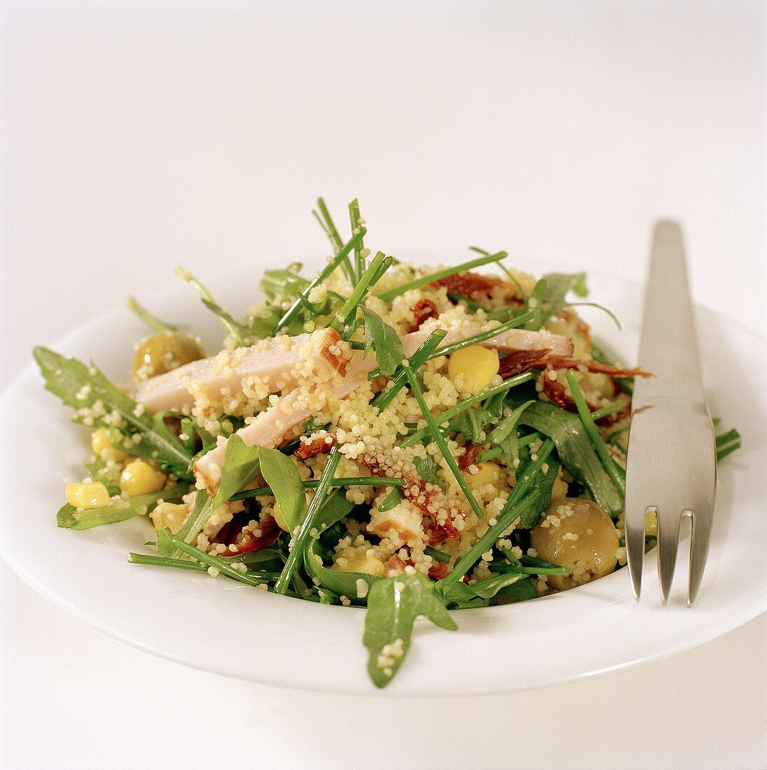Rocket and couscous salad with strips of turkey