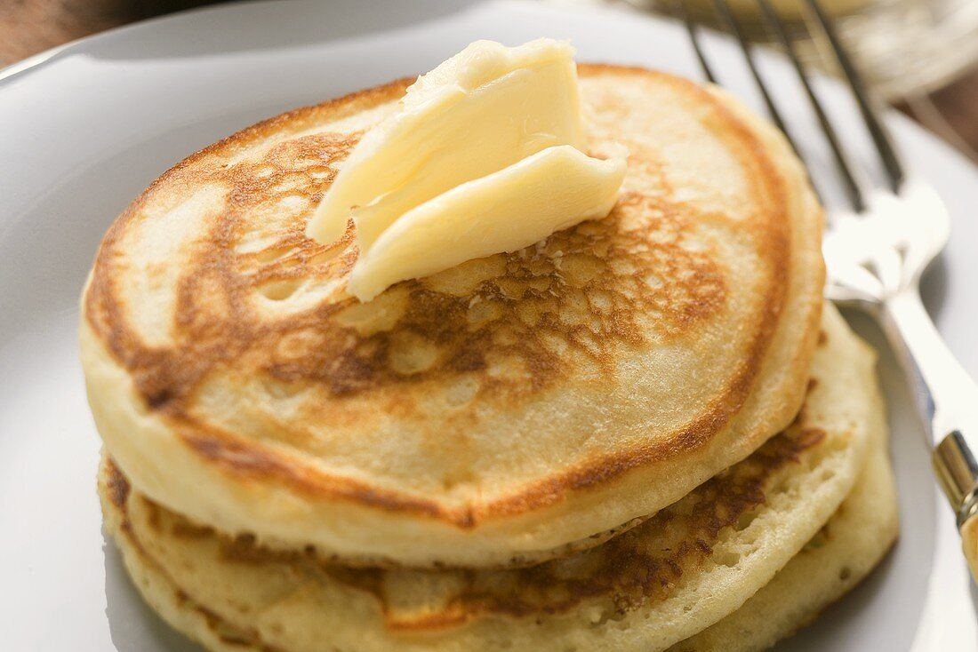 Pancakes with dab of butter on a plate