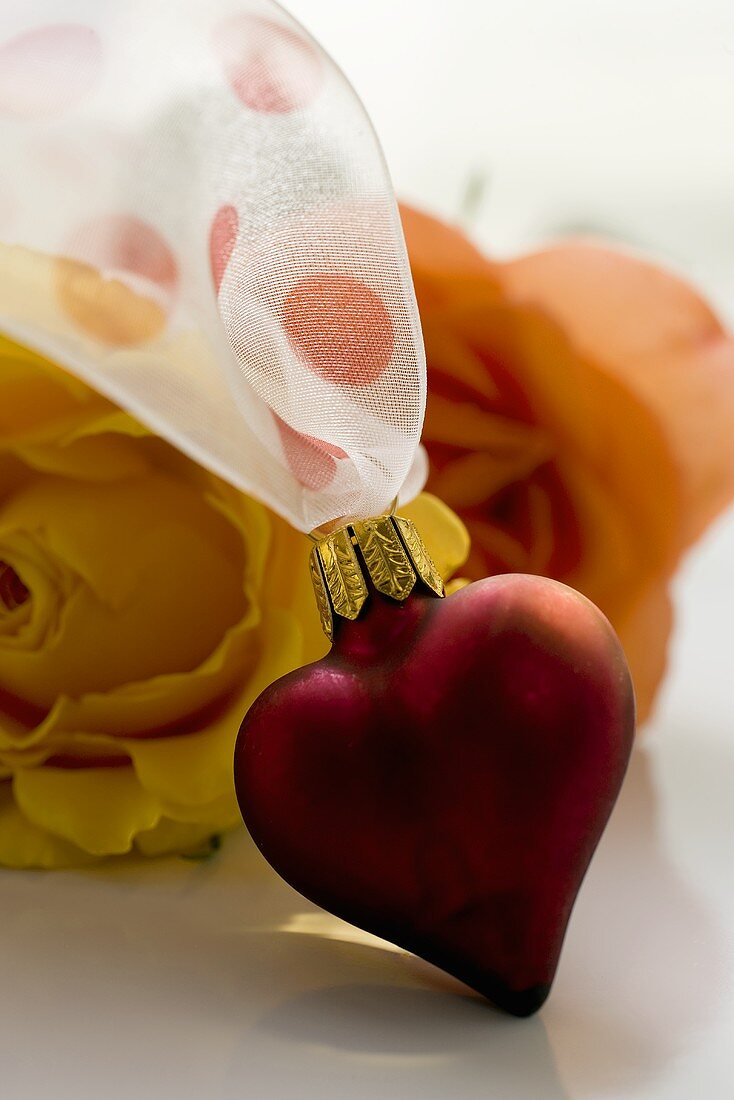 Symbols of love: heart and roses