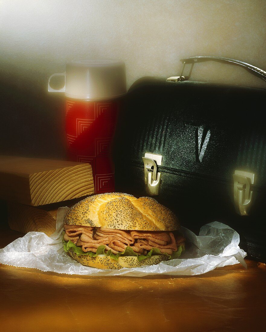 Roast Beef Sandwich on a Poppy Seed Bun; Lunchbox and Thermos