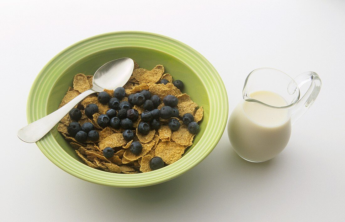 Bran Flake Cereal with Fresh Blueberries; Pitcher of Milk