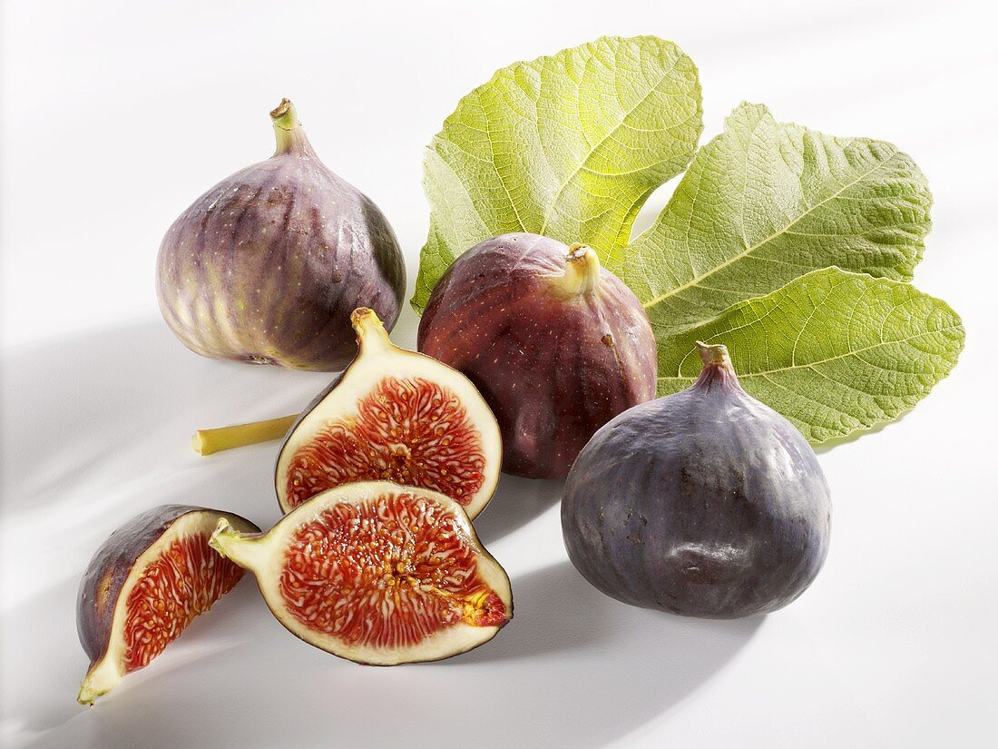 Three whole figs and one cut into pieces