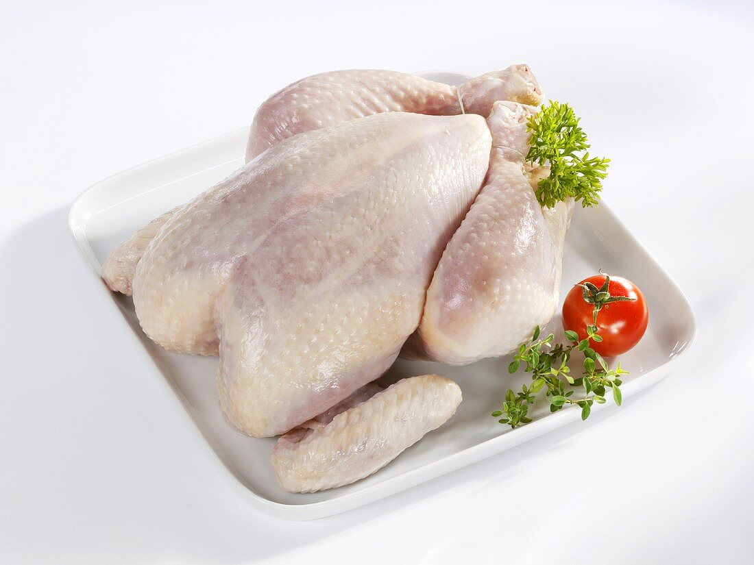 Fresh chicken on a serving plate