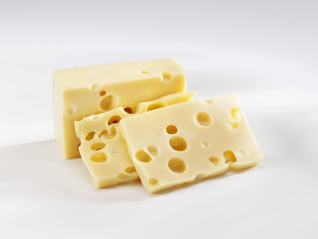 A piece of Emmental cheese and two slices