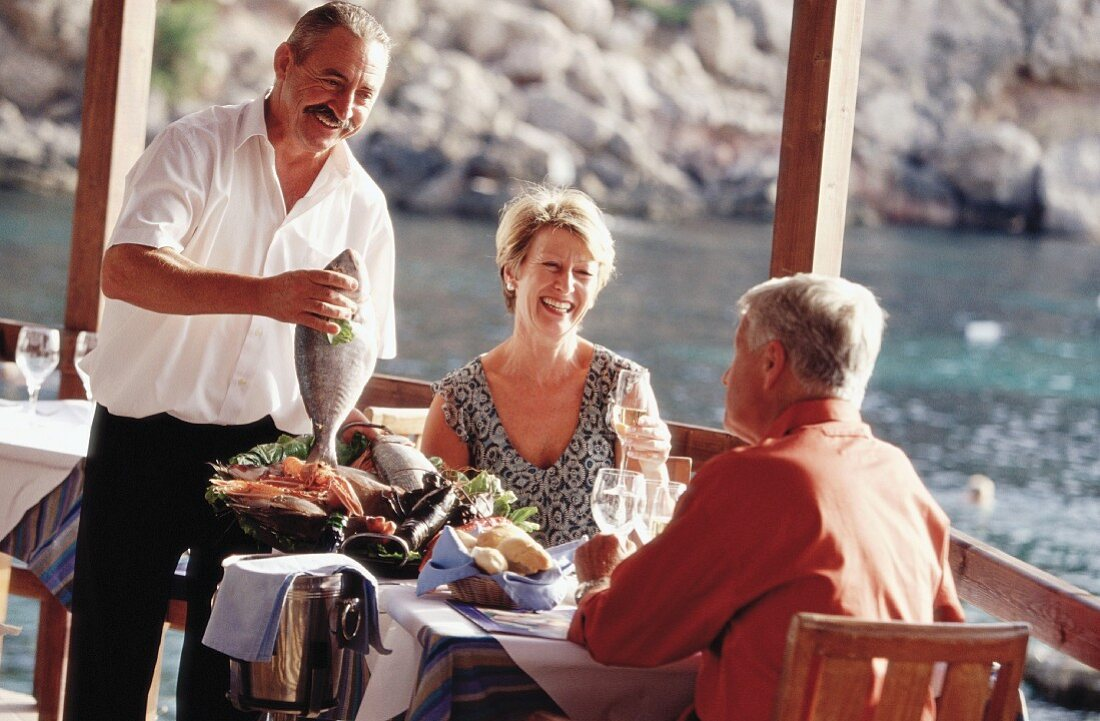 Married couple in restaurant (Greece)