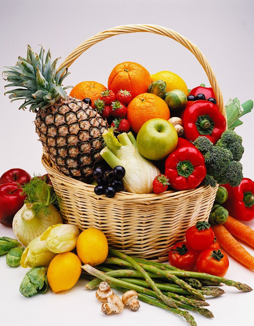 Assorted types of vegetables and fruit in a shopping basket