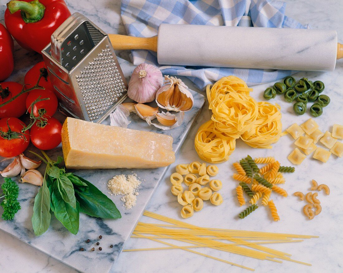 A still life featuring assorted ingredients for pasta dishes