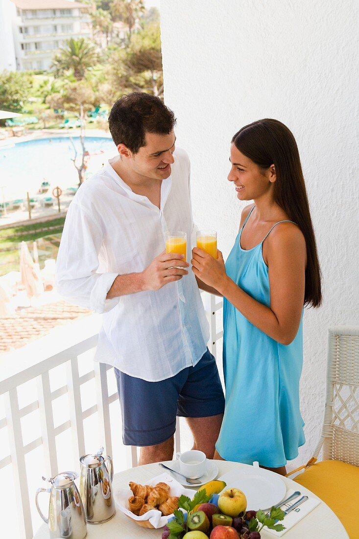 Couple on holiday eating breakfast on balcony