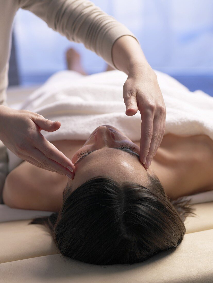 Woman having her temples massaged