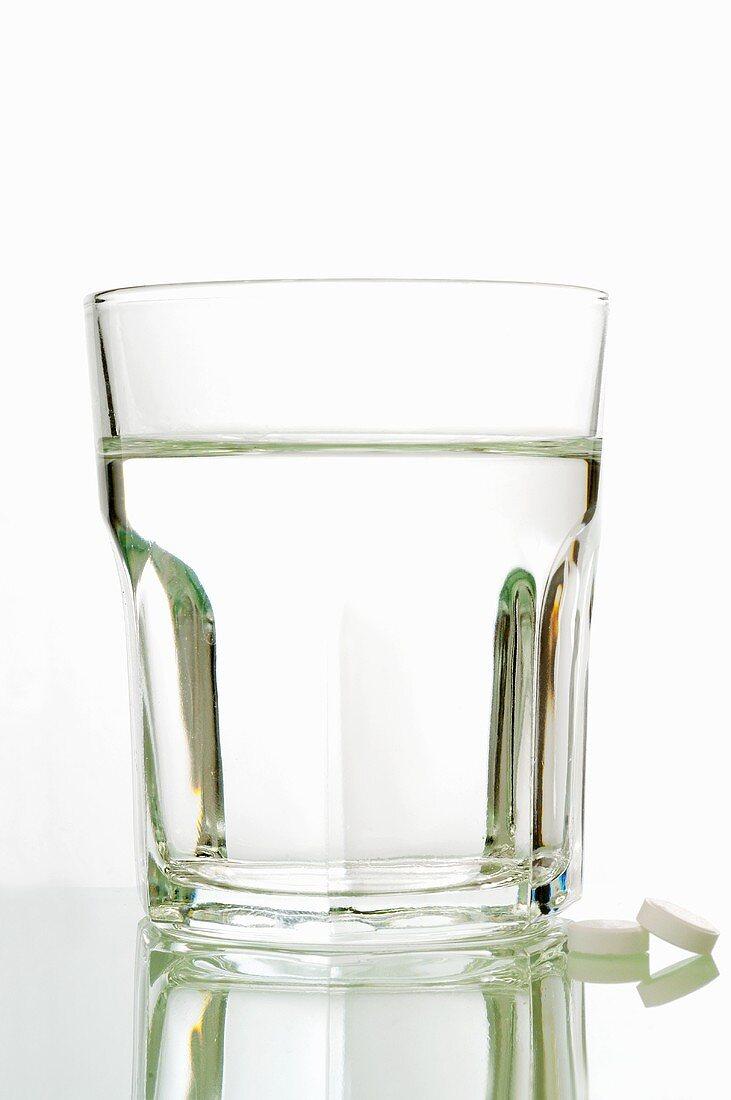 Schüssler Salts tablets with a glass of water