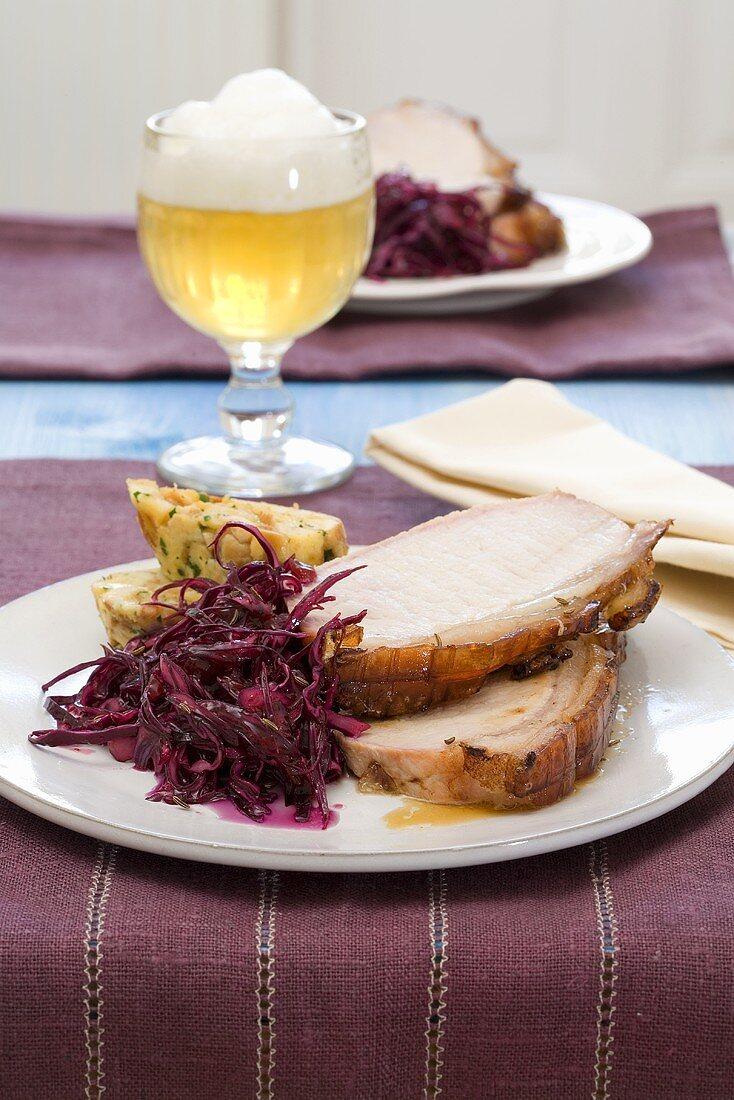 Salzburg beer-roast pork with red cabbage and pretzel napkin dumplings
