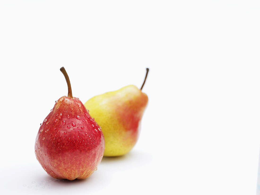 Two Williams pears with drops of water