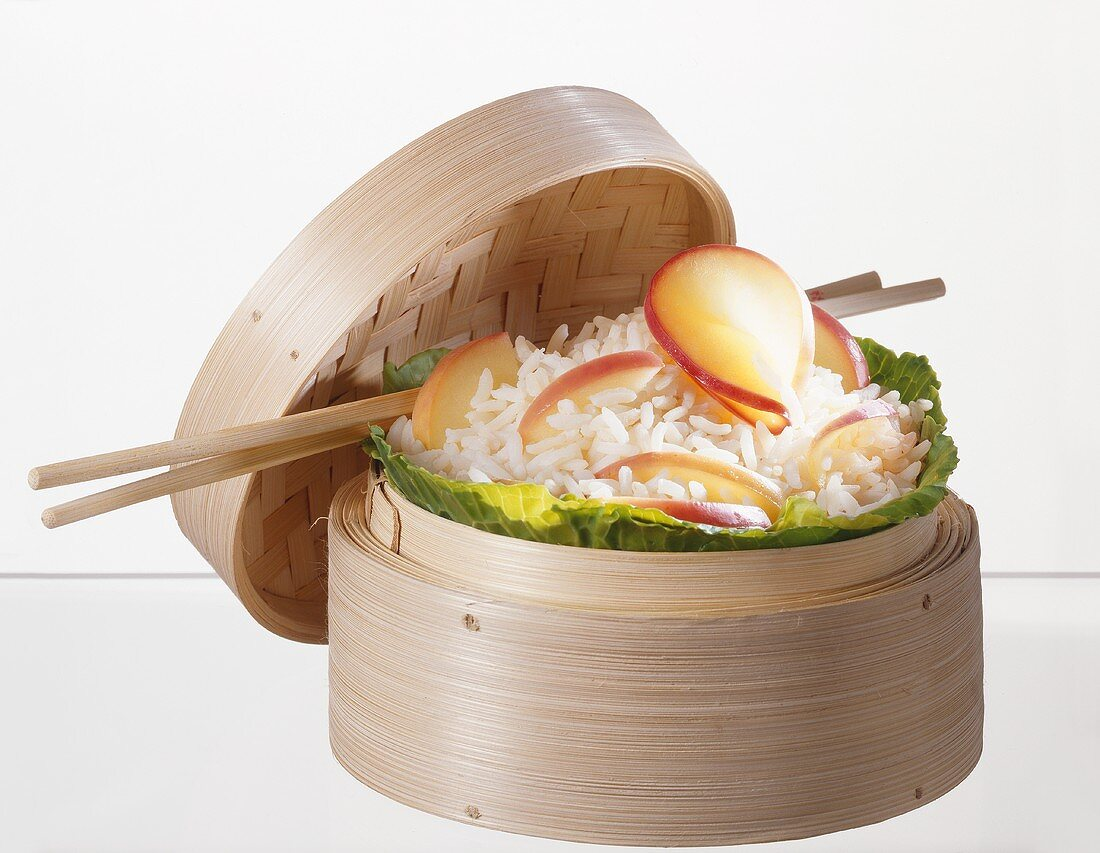 Rice with apple in steaming basket