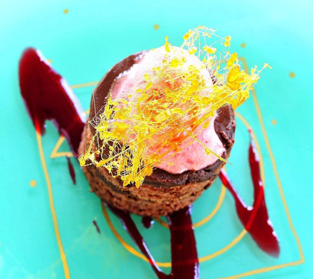 Chocolate fancy with raspberry cream and caramel strands