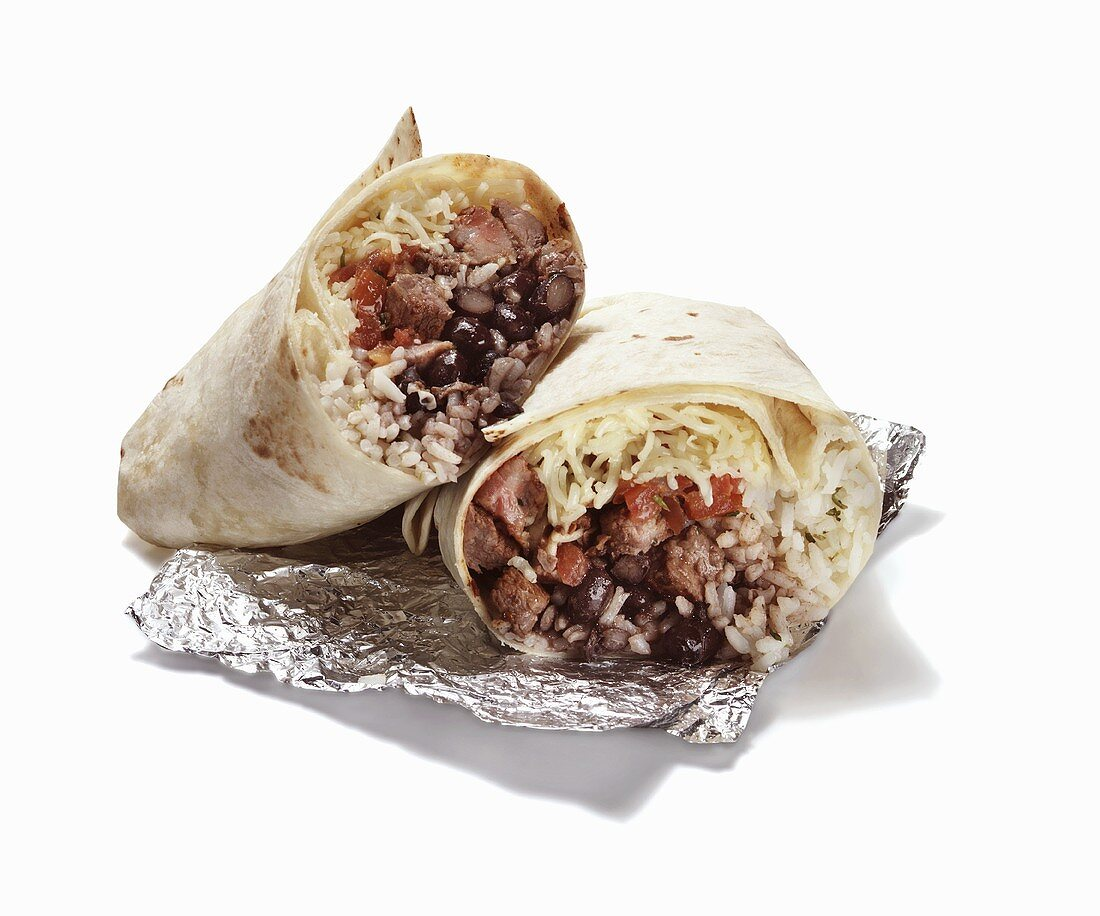Rice and Bean Burrito Halved on Foil