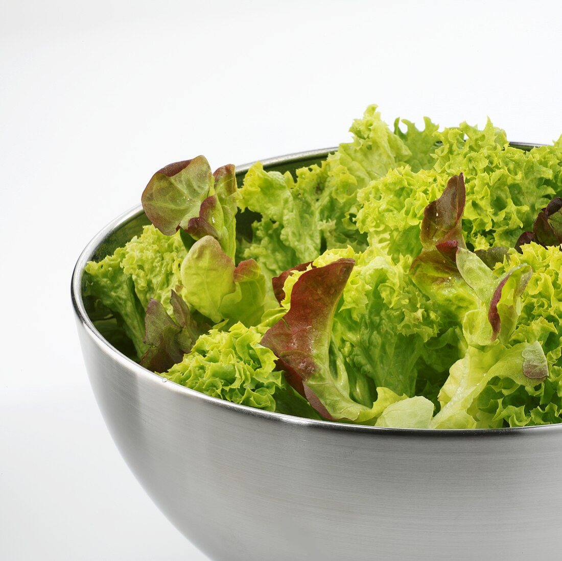 Green salad in stainless steel bowl