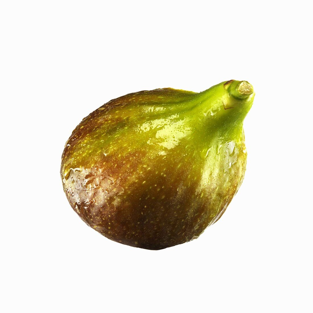 A fresh fig with drops of water