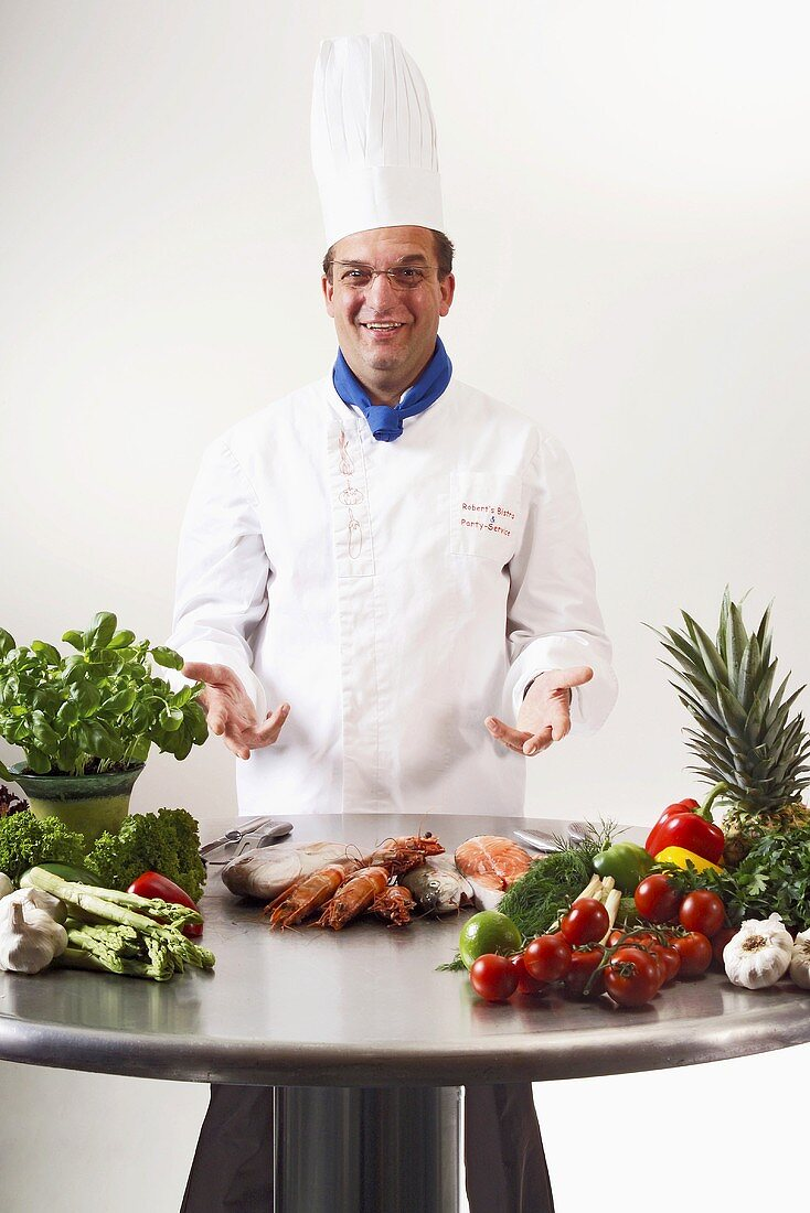 Chef presenting fresh ingredients on table