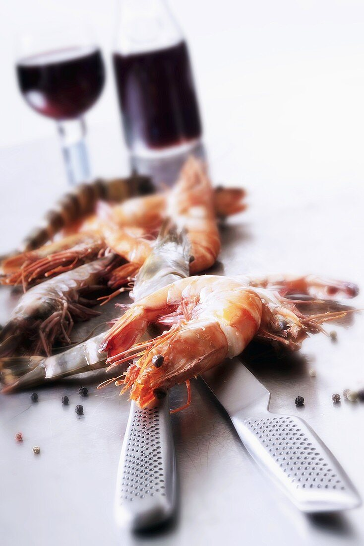 Prawns, knife and red wine