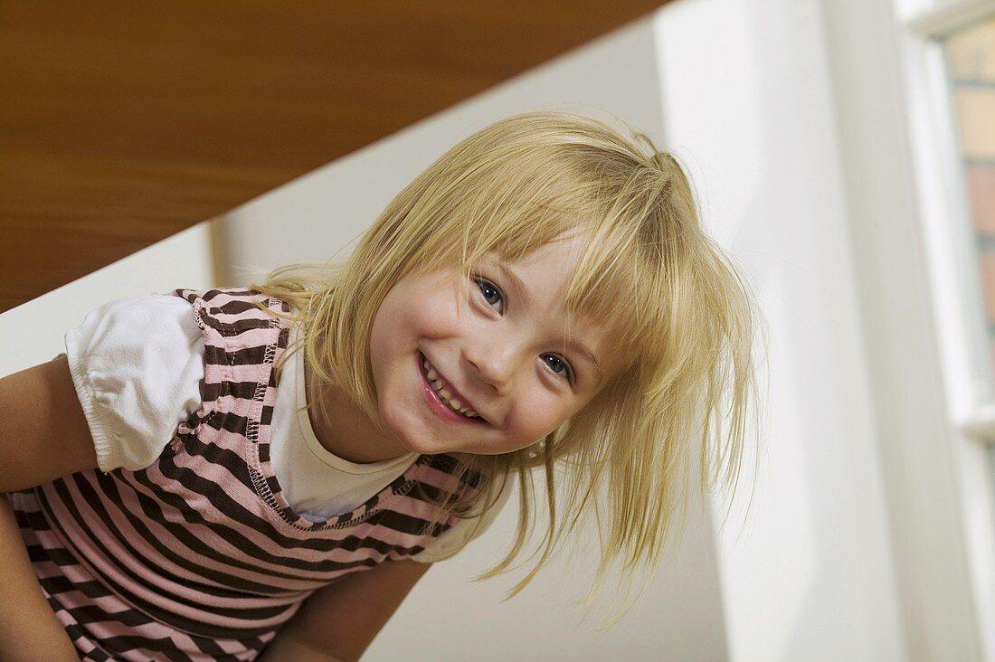 Blond girl smiling for camera