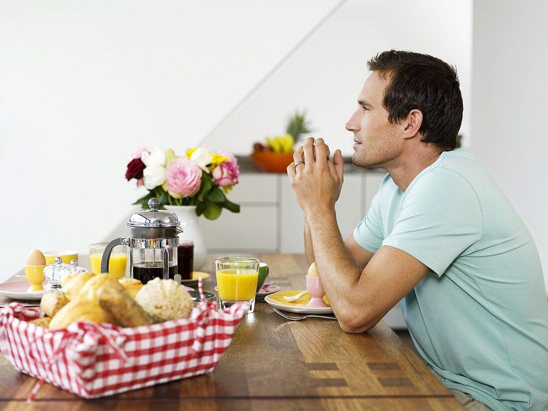 Man sitting at breakfast table