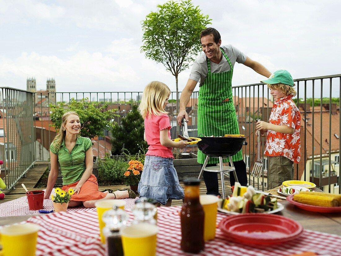 Family having barbecue on balcony