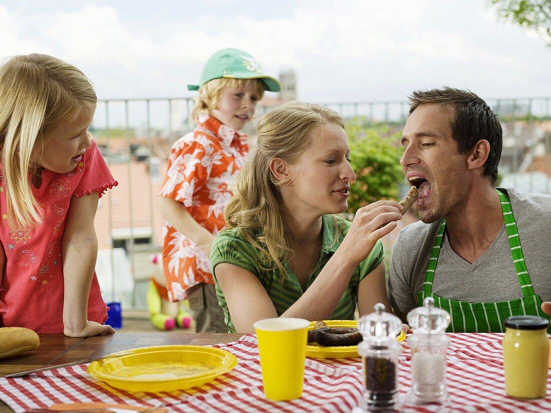 Family eating on balcony