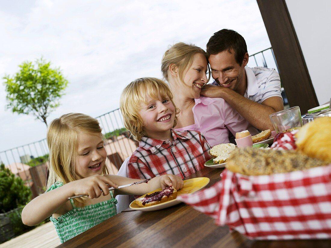 Family having breakfast on terrace