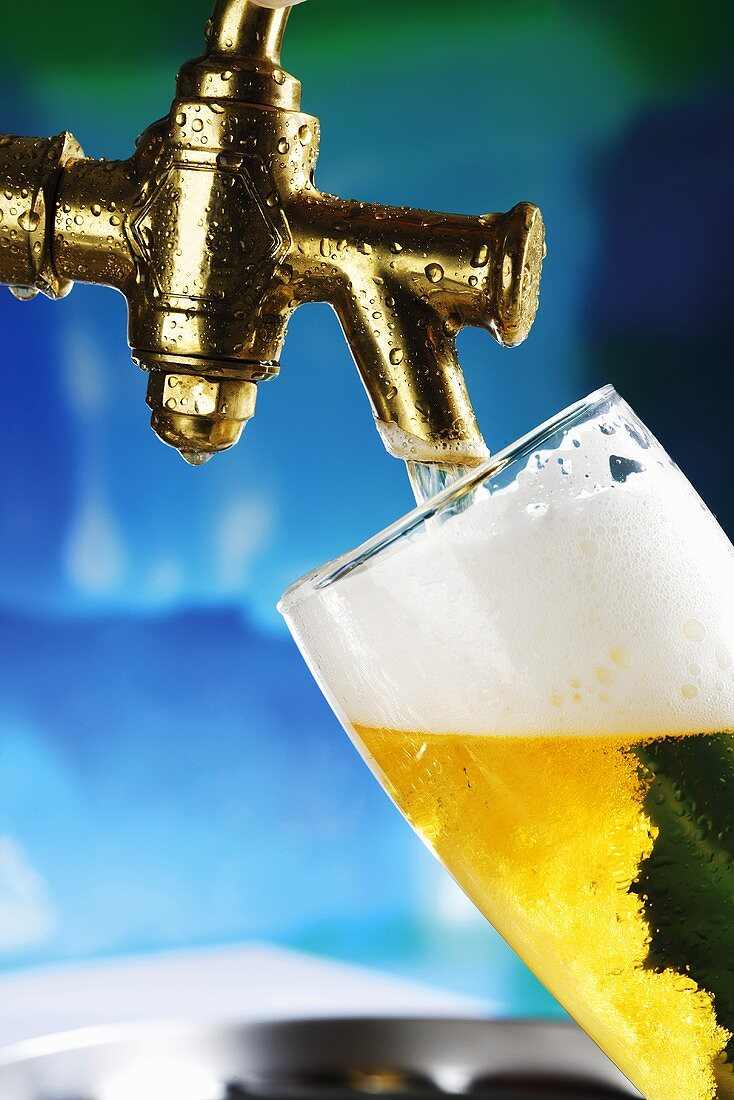 Beer pouring in glass, close-up