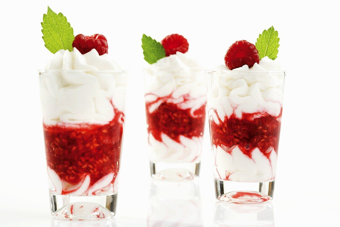 Raspberry puree with cream in three glasses