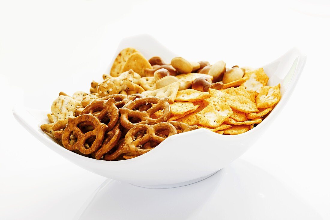 Assorted snacks in bowl, close-up
