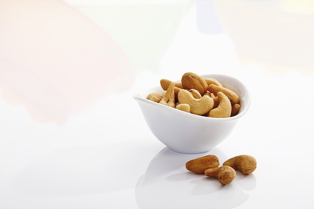 Cashews in and beside bowl