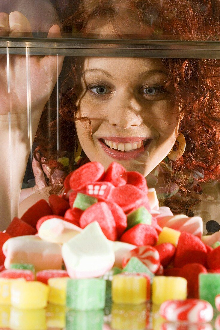 Young woman looking at sweets
