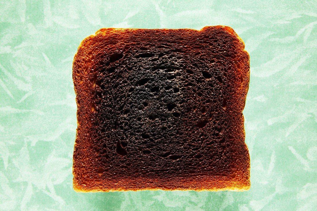 Slice of burned toast, close-up