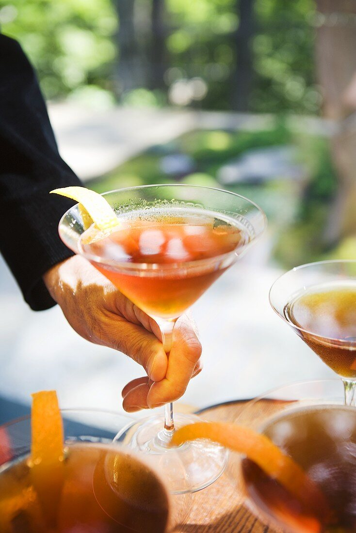 Hands Holding Cocktails; Outdoors