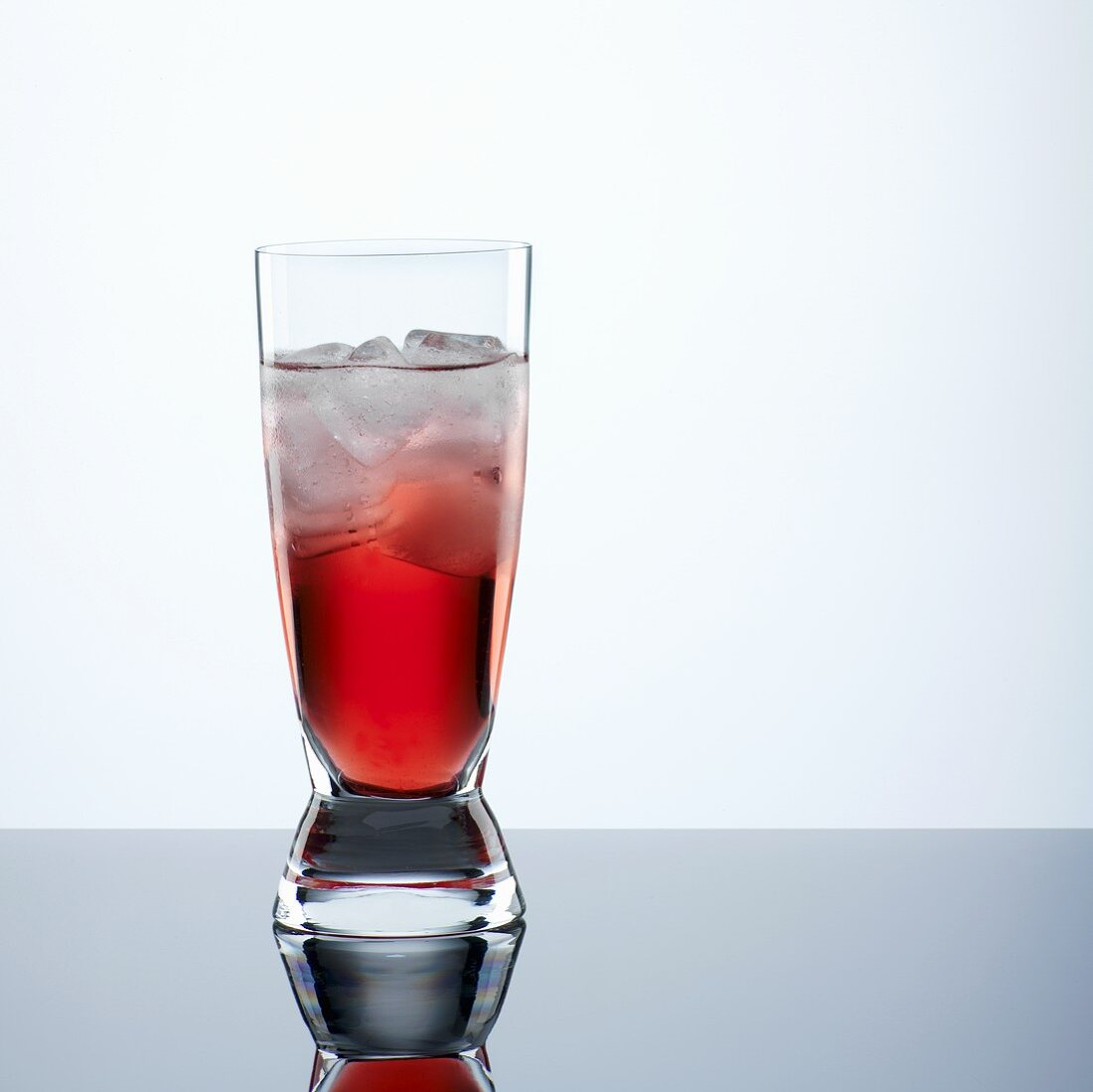 Campari with ice cubes in glass