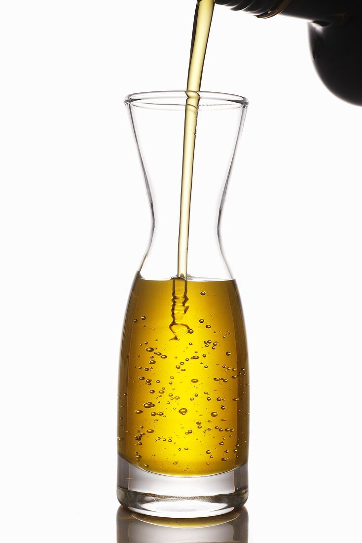 Pouring olive oil into a carafe