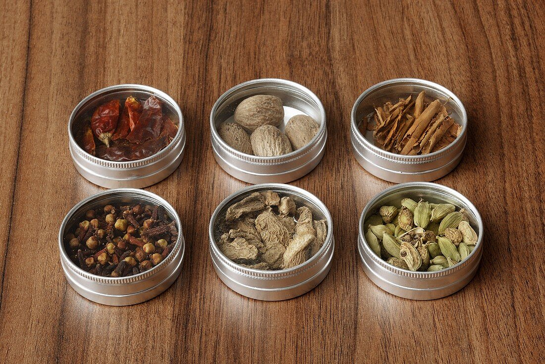 Assorted spices in small tins