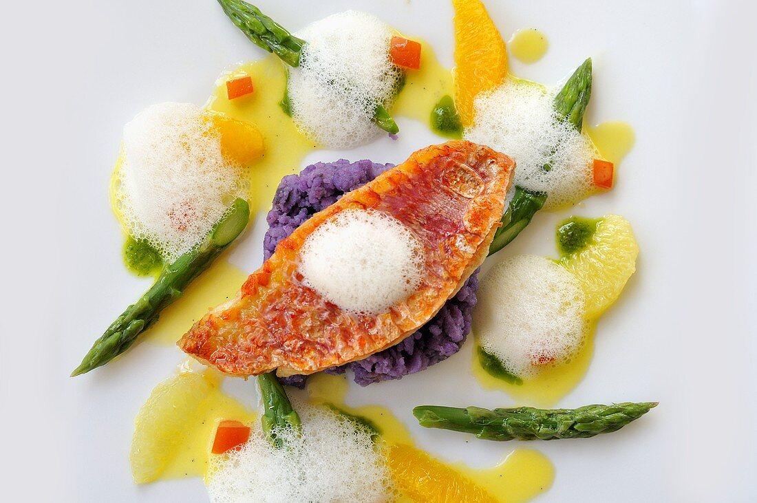 Red mullet with asparagus, purple potatoes and citrus fruit