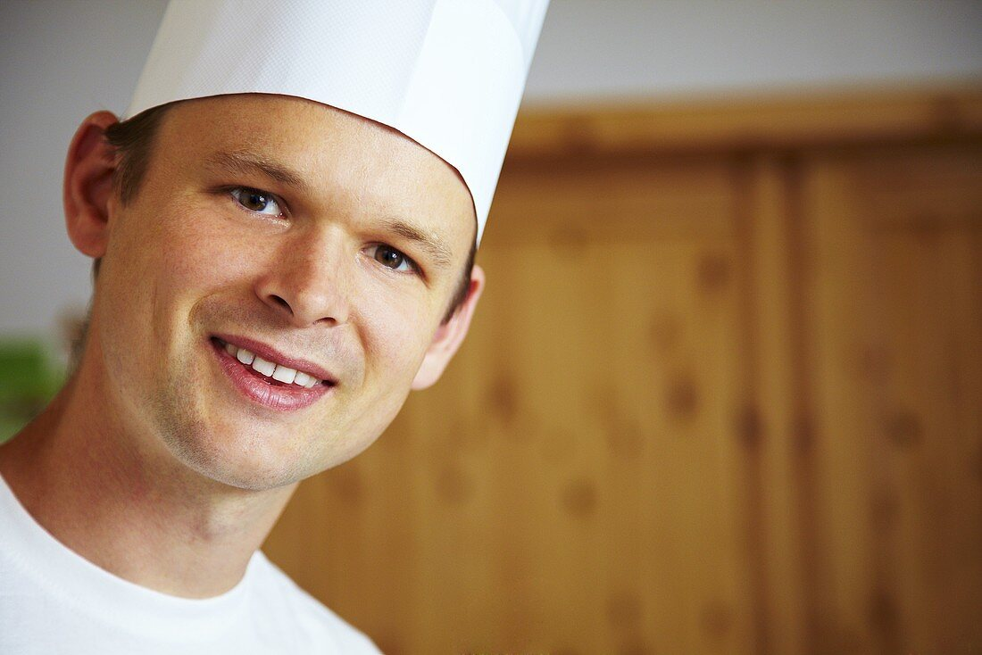 Young chef looking into camera