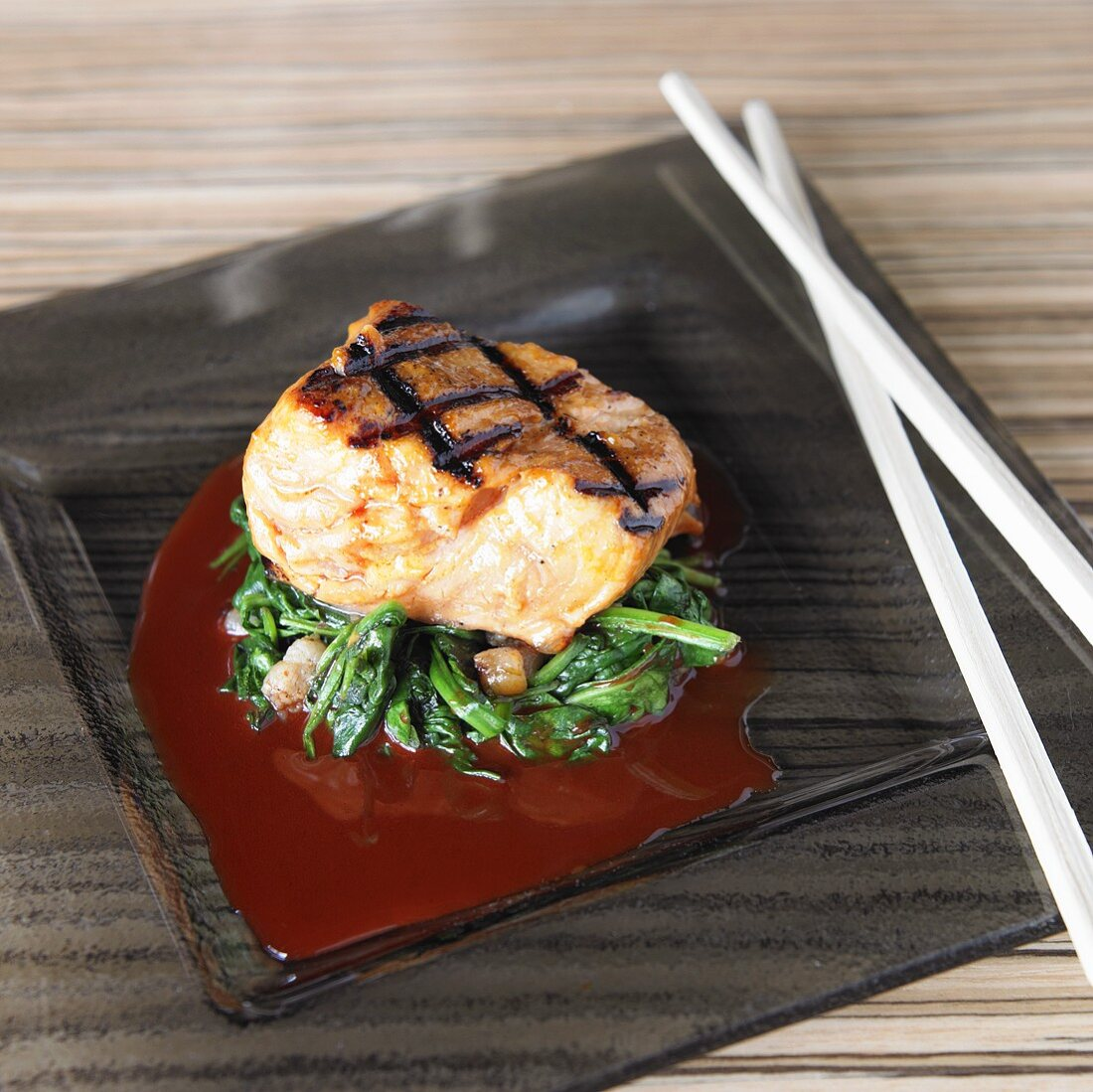 Grilled salmon fillet with greens, achiote and ponzu sauce