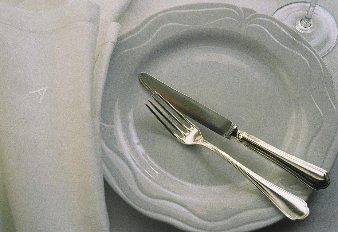 White Plate and Silverware; Cloth Napkin
