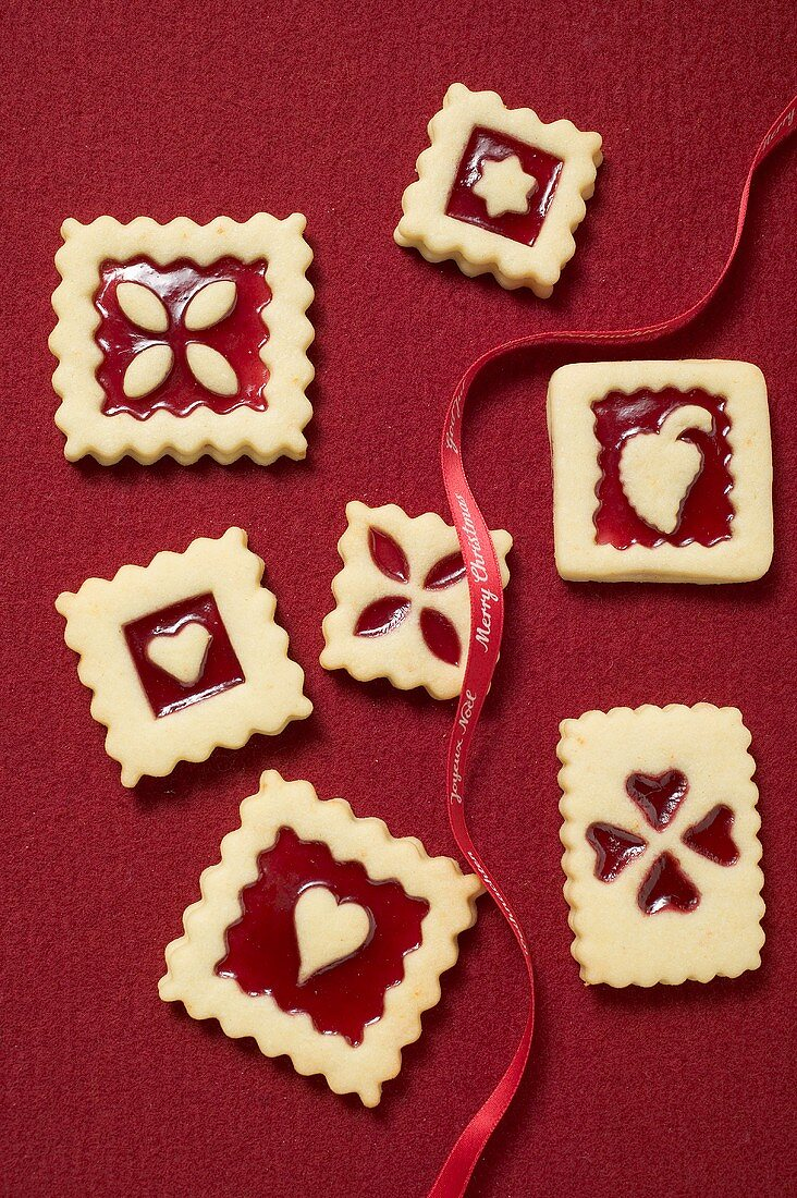 Seven square jam biscuits with red ribbon