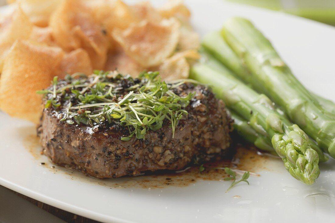 Peppered steak with cress, green asparagus & potato crisps