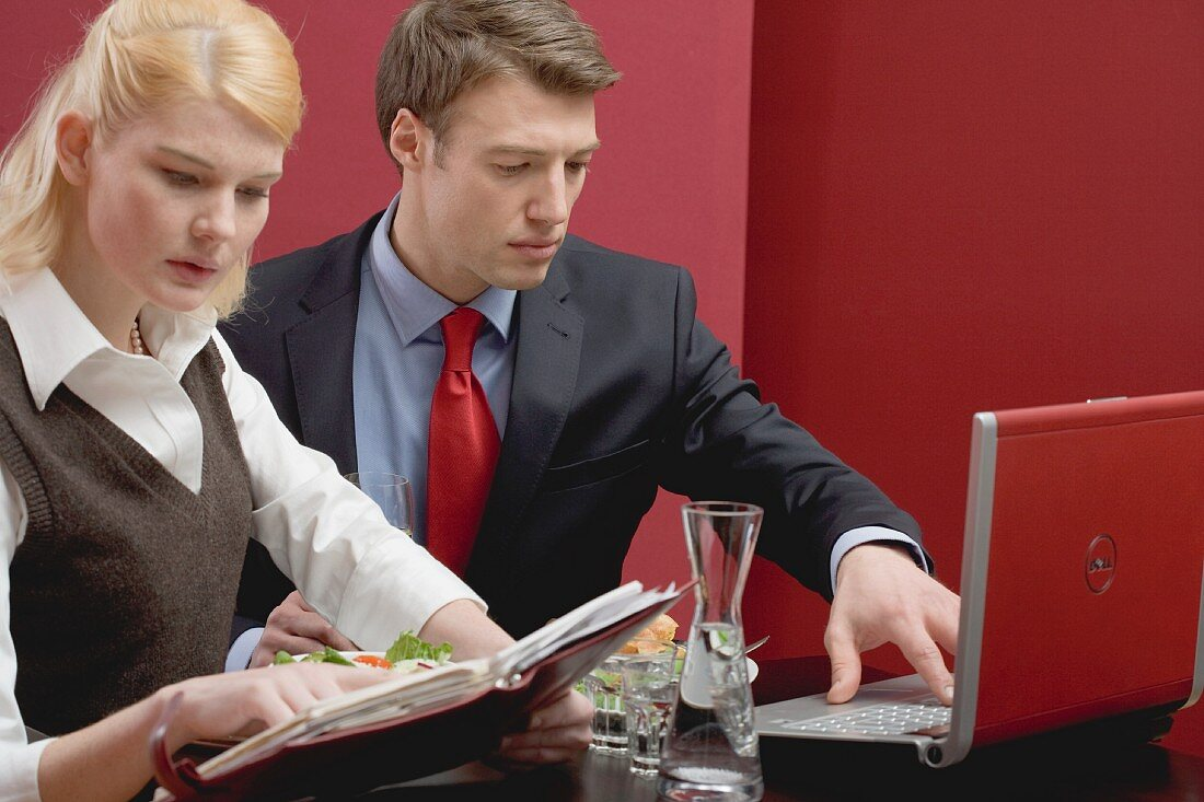 Office colleagues working through lunch to meet deadline