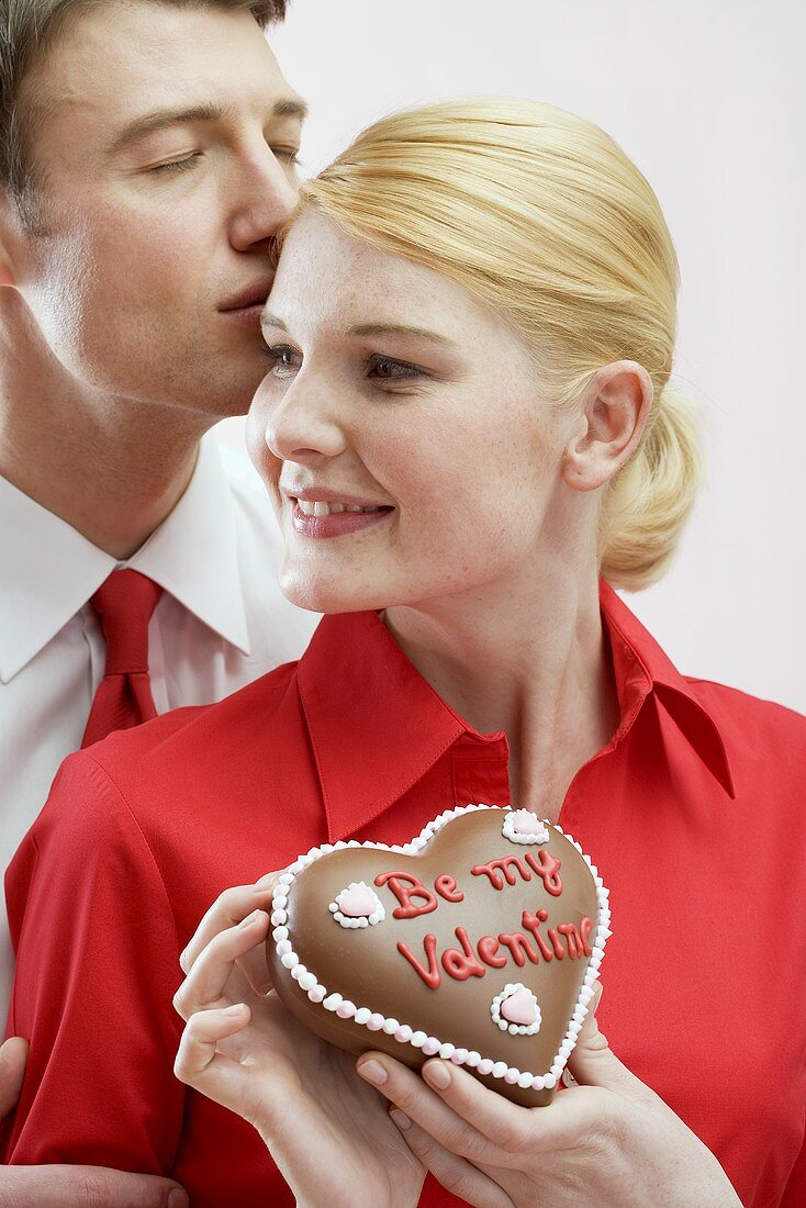 Couple with chocolate heart on Valentine's Day