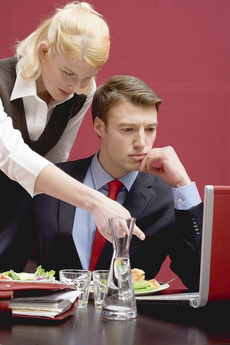 Office colleagues working through lunch