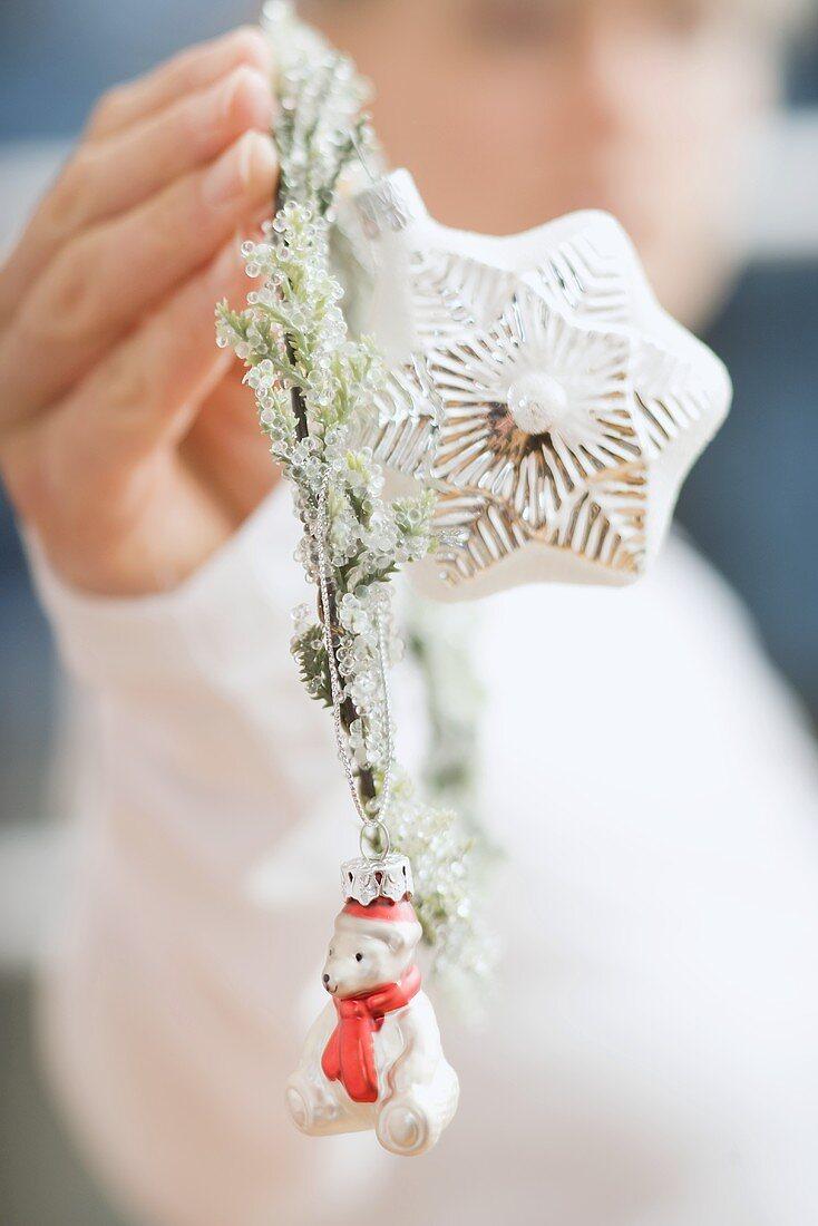 Woman holding Christmas tree ornaments
