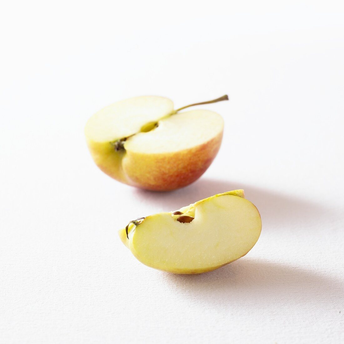 Half an apple and a wedge of apple
