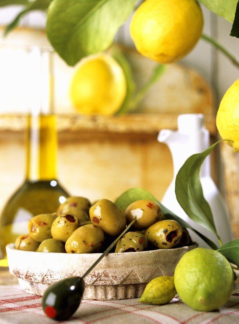 Marinated green olives, lemons, olive oil